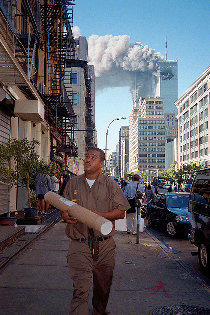 10 - UPS delivery man making a drop as the WTC burns behind him