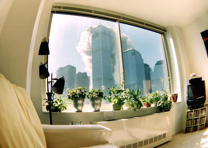 11 - Wide angle pic from someone's living room of the World Trade Center coming down.