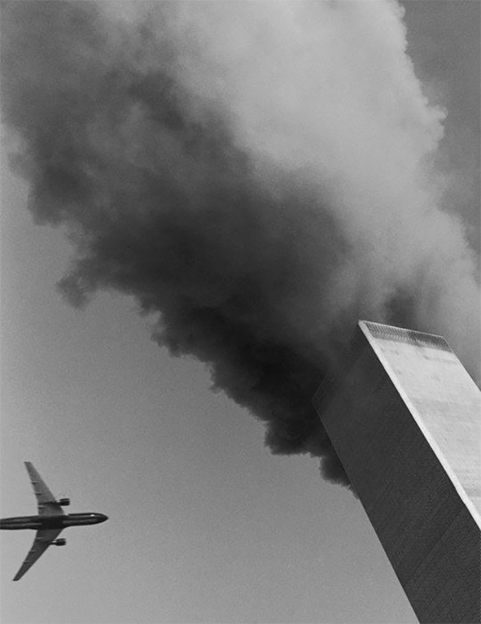 12 - Black and white photo of airplane going into the tower on September 11th 2001