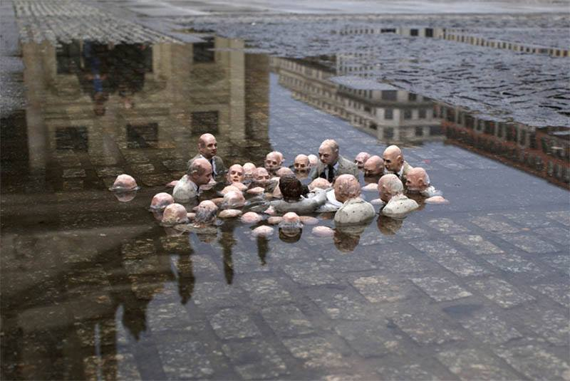 "25 - Sculpture by Issac Cordal in Berlin, called ""Politicians Discussing Global Warming"""