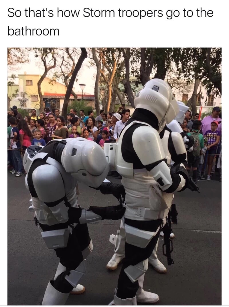 12 - Stormtroopers helping each other get dressed.