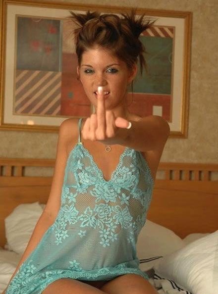 Topless teen in bed middle finger #13