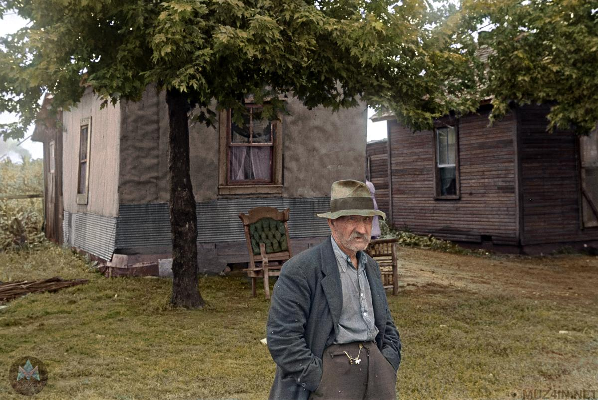 6 -  An elderly man outside his tiny home during the Depression.