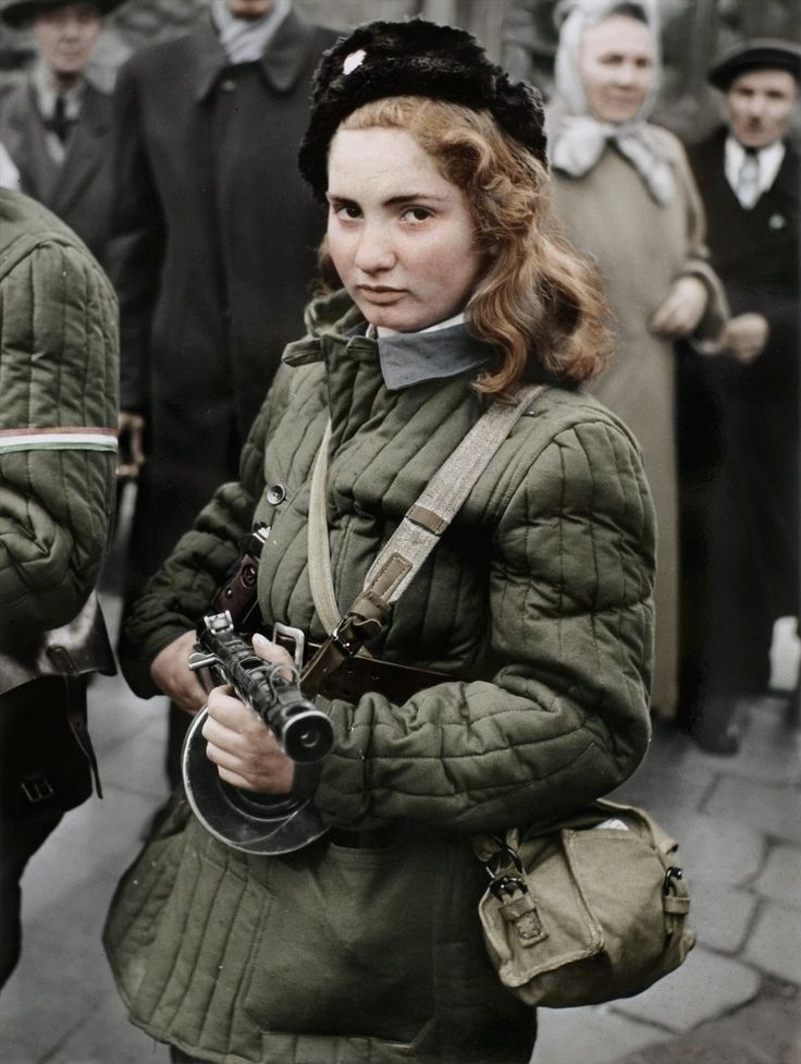7 -  Erika, 15, a Hungarian Freedom Fighter, carries a machine gun in Budapest during the revolution, 1956, she was eventually shot by the Soviets