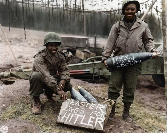 "9 -  African American soldiers posing with rockets labeled with the phrase ""Happy Easter Adolph"", 1945"