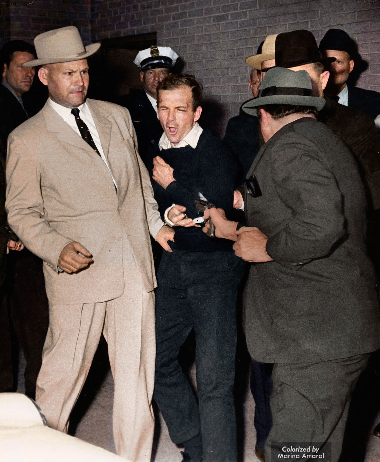 16 -  Lee Harvey Oswald the moment he was assassinated
