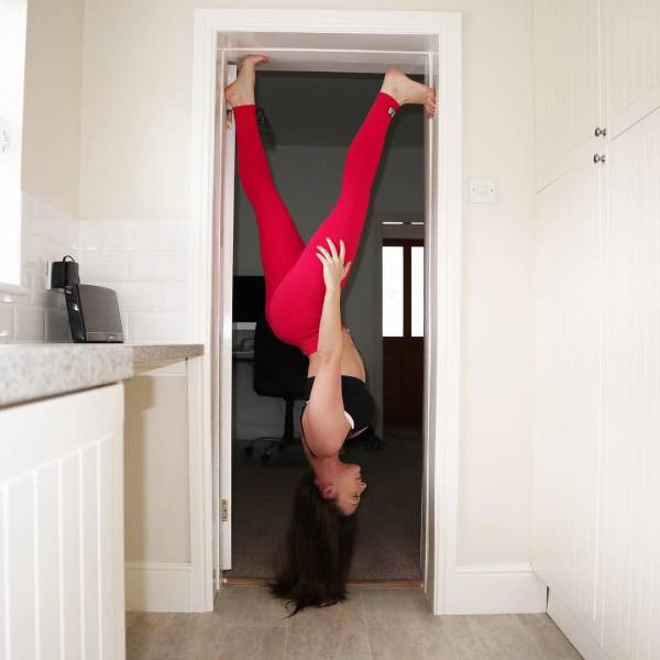 3 - Girl walking upside down in a door way.