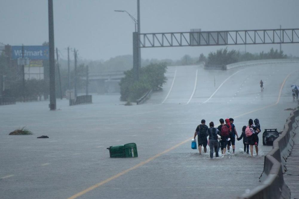 6 - Hurricane Harvey as kids walk along the flooded road