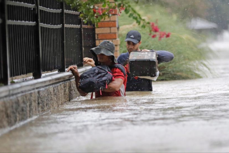 8 - People walking through flooded areas after Hurricane Harvey