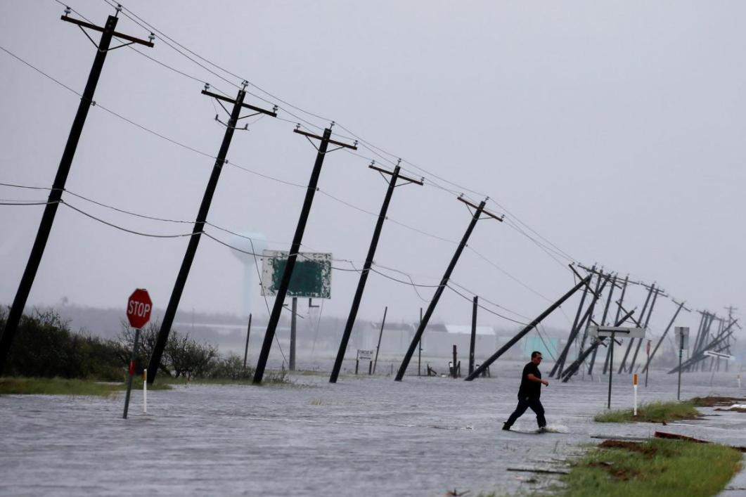 16 - Phone poles slanted by Hurricane Harvey