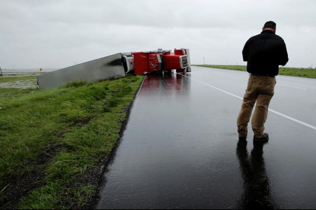 17 - Truck overturned on highway from Hurricane Harvey