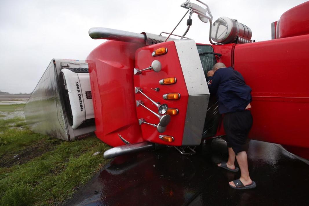 21 - Checking inside the semitrailer that flipped in Hurricane Harvey