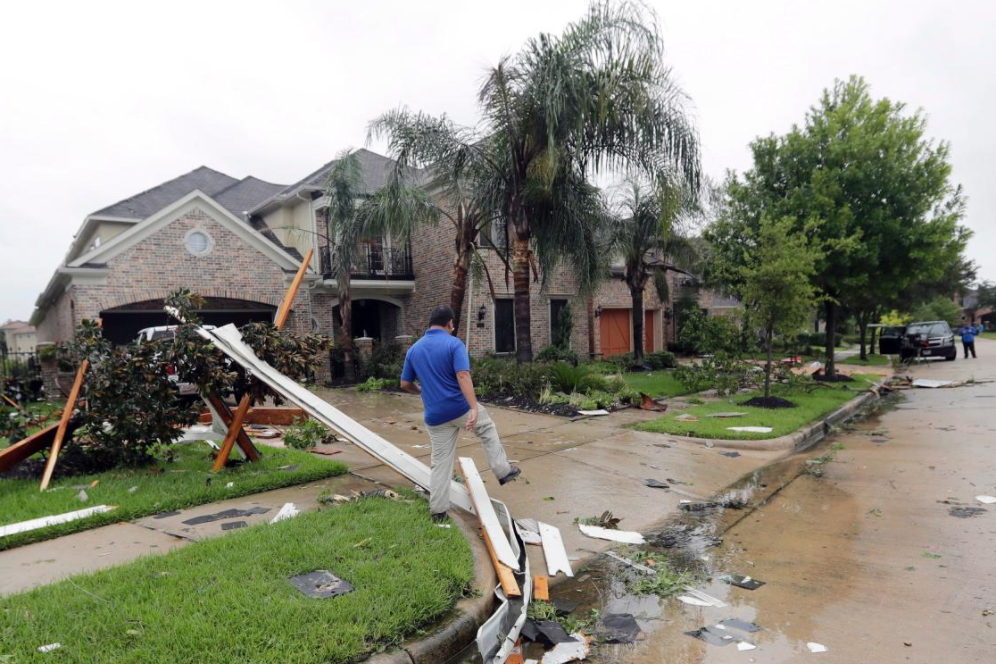 28 - Fully intact house with some minor street damage after Hurricane Harvey