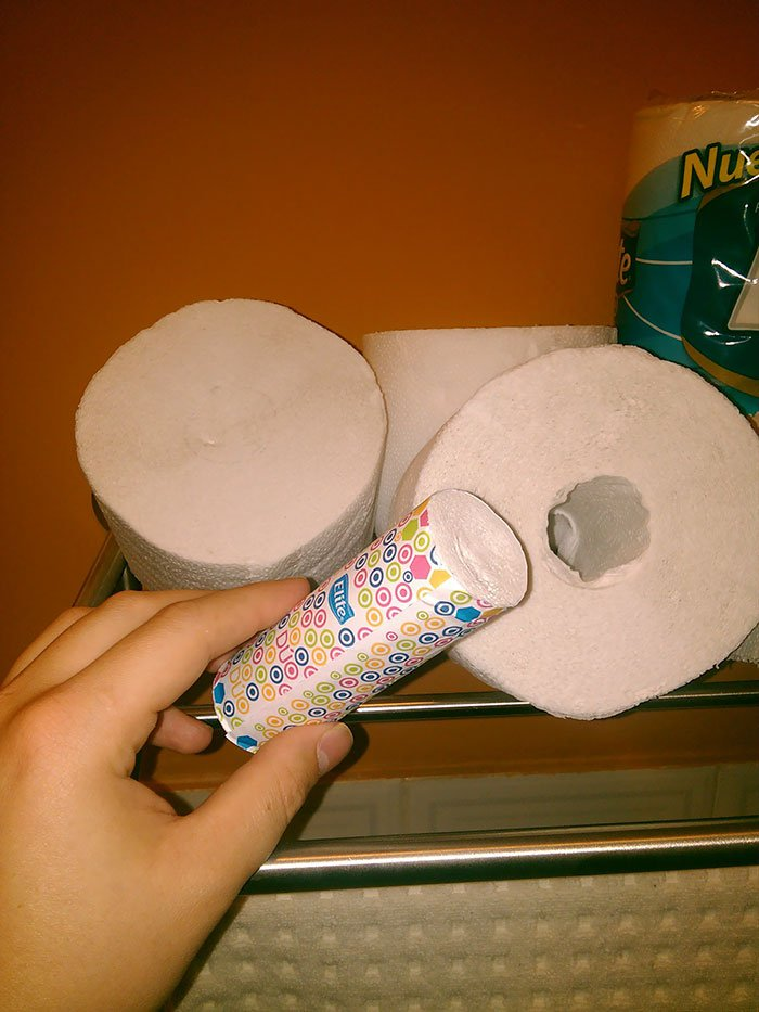 A toilet paper roll with a smaller roll inside to on the go.