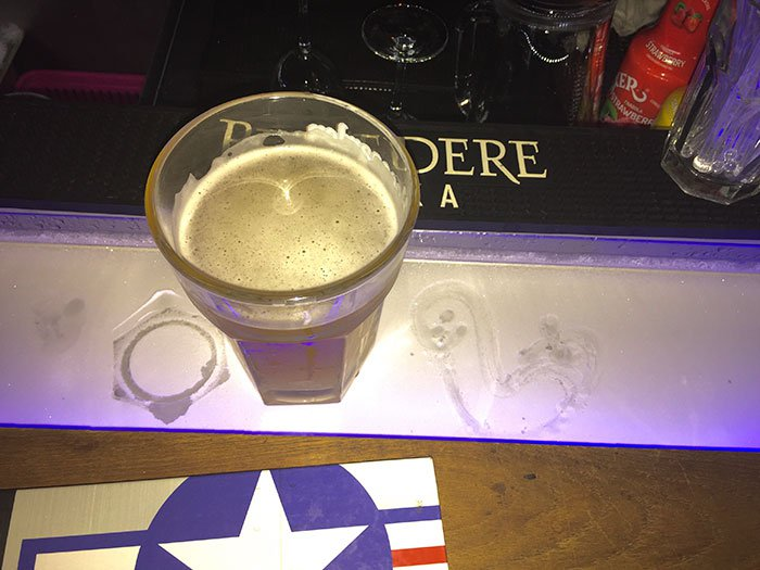 This bar top has a refrigerated well in it to keep your drink cold.