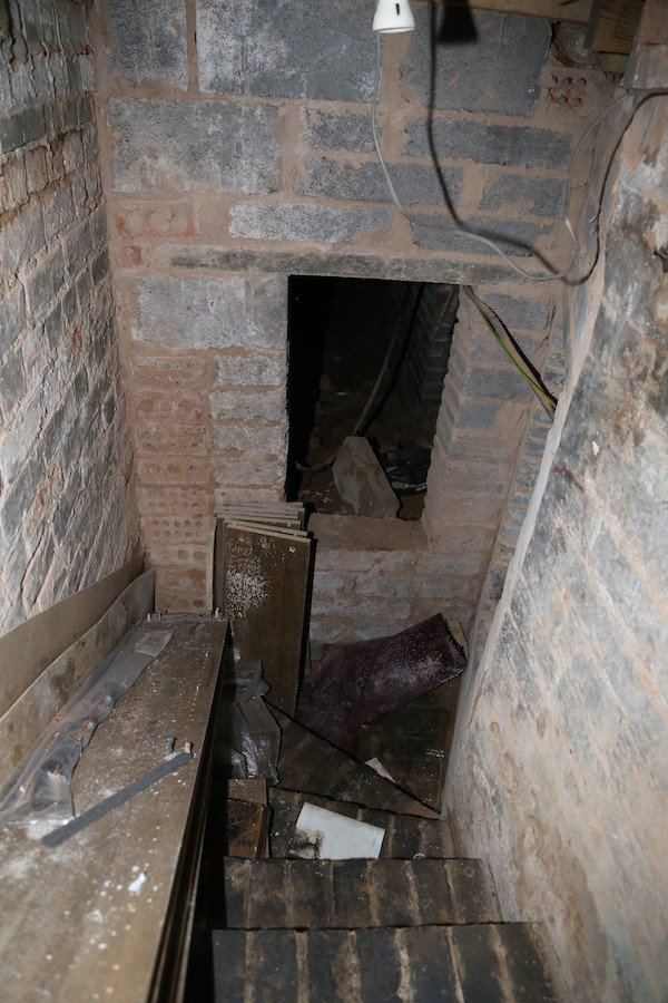 11 - It's a dungeon. An actual freaking dungeon below his place, that possibly spanned the footprint of the building. He wasn't brave enough to do it alone, so he wedged his bathroom door over the closed hatch and called a friend.