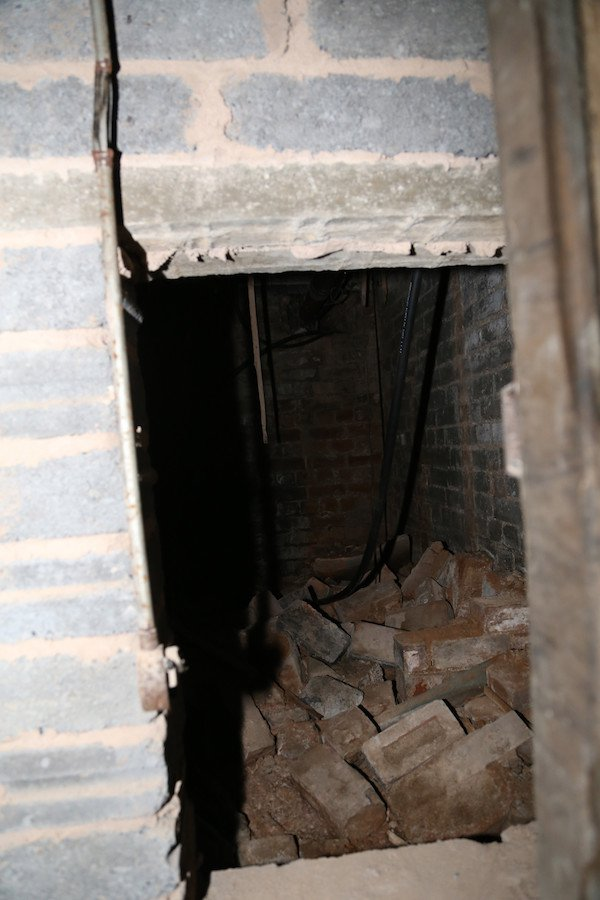 14 - This space is underneath a neighbours apartment. It's just an empty space full of bricks.