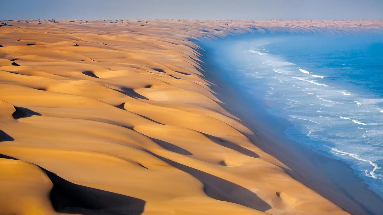 11 - The Namib Desert meets the Atlantic ocean in Africa Where the Namib Desert meets the Atlantic Ocean, Africa