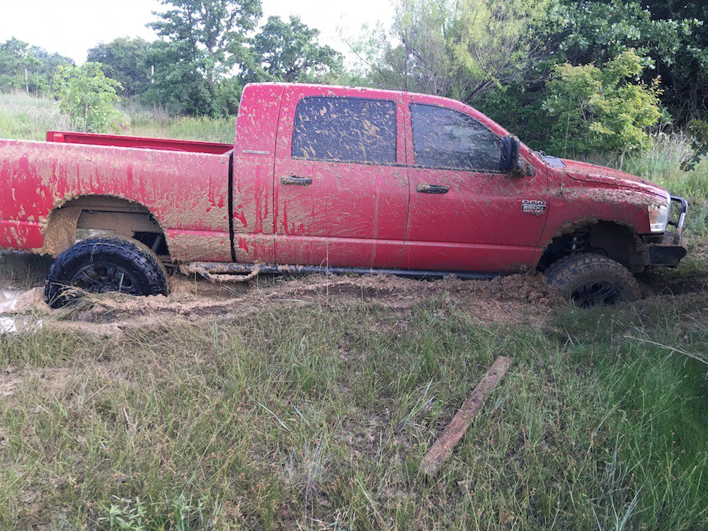 1 - Pickup truck stuck in the mud pretty badly