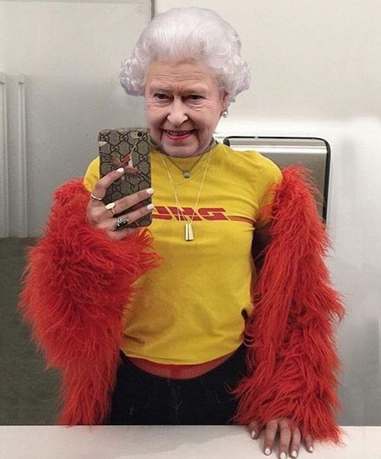 11 - Queen of England taking selfie wearing t-shirt and some furry outfit