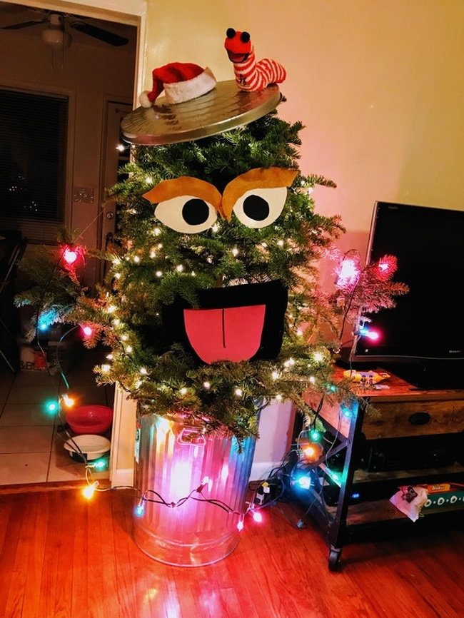 """9 - """"While shopping for a tree this year, my husband and I spotted an ugly misfit — oval-shaped and flat on the top with a huge gap in the middle. We were instantly inspired! Meet Oscarmas."""""""