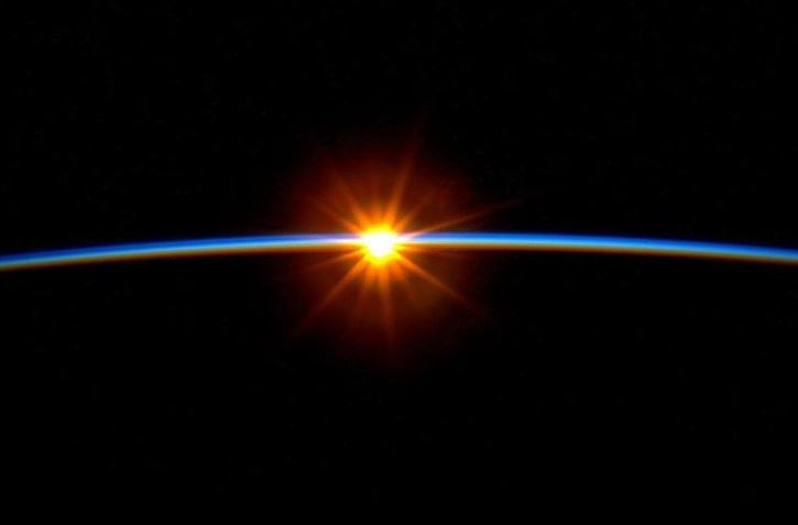 13 - A sunrise photographed from space.