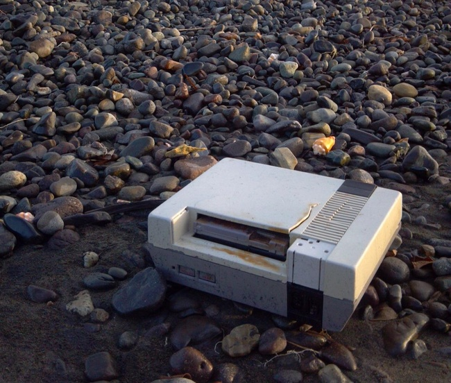"19 - ""I found an NES with a game stuck in it washed up on the beach today."""