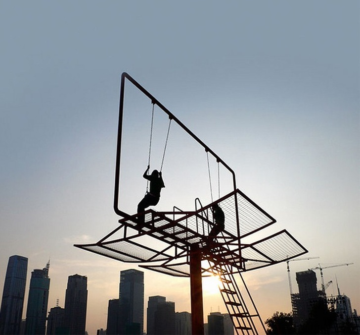 14 - A billboard converted into swings