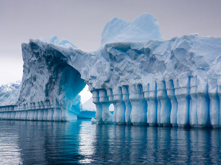 9 - A naturally formed ice shelf shaped by water