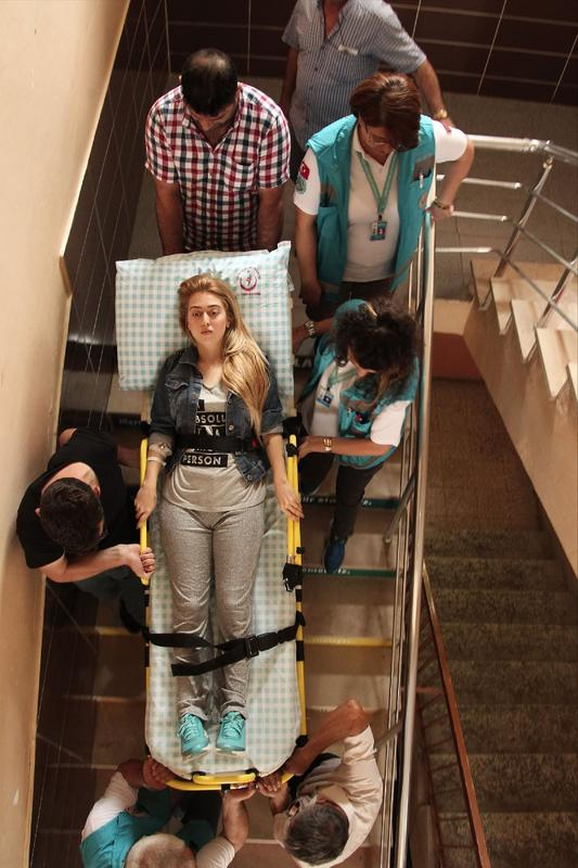 6 - Hospitalized Turkish woman is being carried to the polling station to vote for the historic election. Voter turnout is expected to be over 90%.