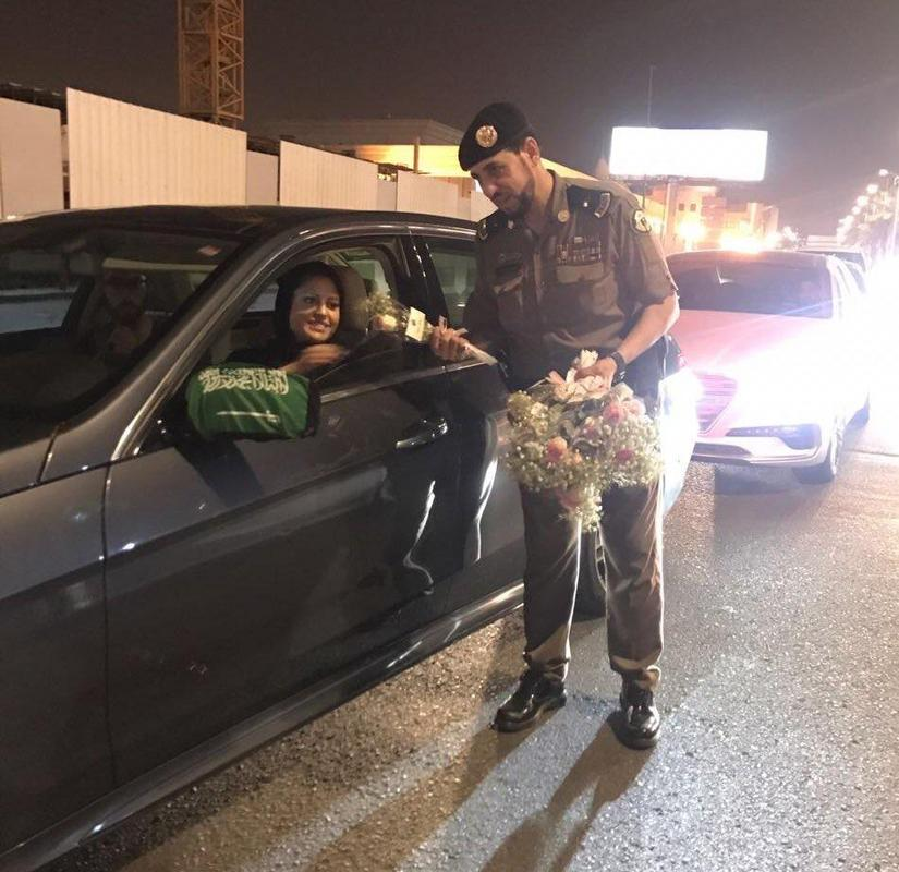 12 - Saudi police officers hand out roses to female drivers. (Today is the first-day women can legally drive in Saudi Arabia)