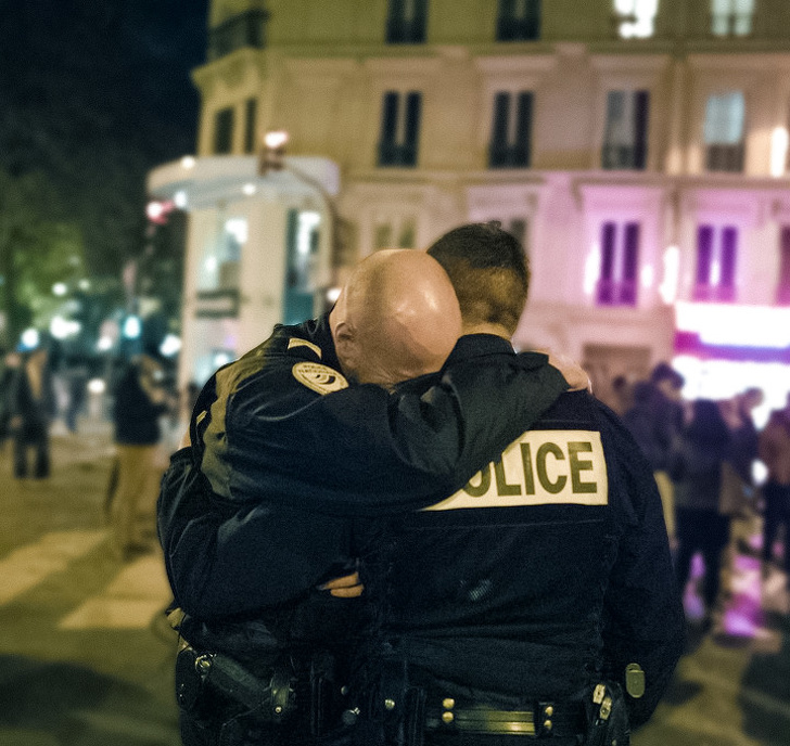 9 - A policeman breaking down after an attack in France.