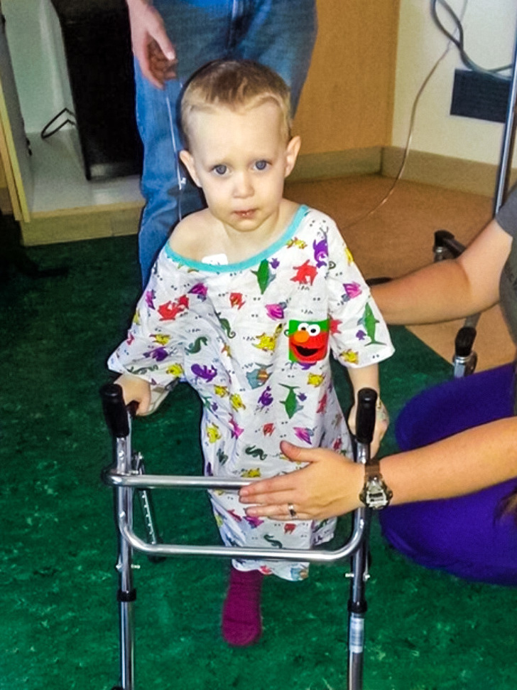 16 - A boy is taking his first steps after a difficult surgery. He had gotten run over by a car.