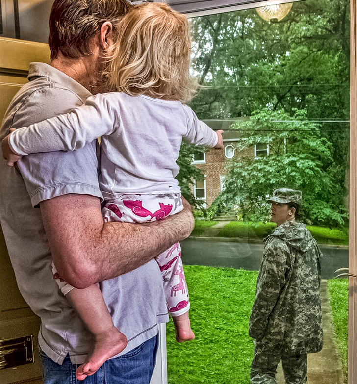 17 - Dad and daughter watching their soldier mom leave for a year.