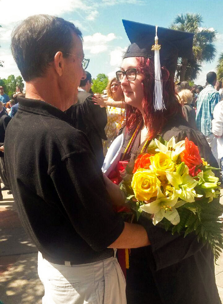 18 - After a number of problems, including alcoholism, she managed to graduate with honors. And her dad is proud of her!