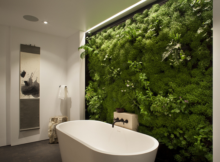 13 - Bring nature inside your bathroom with a vertical garden.