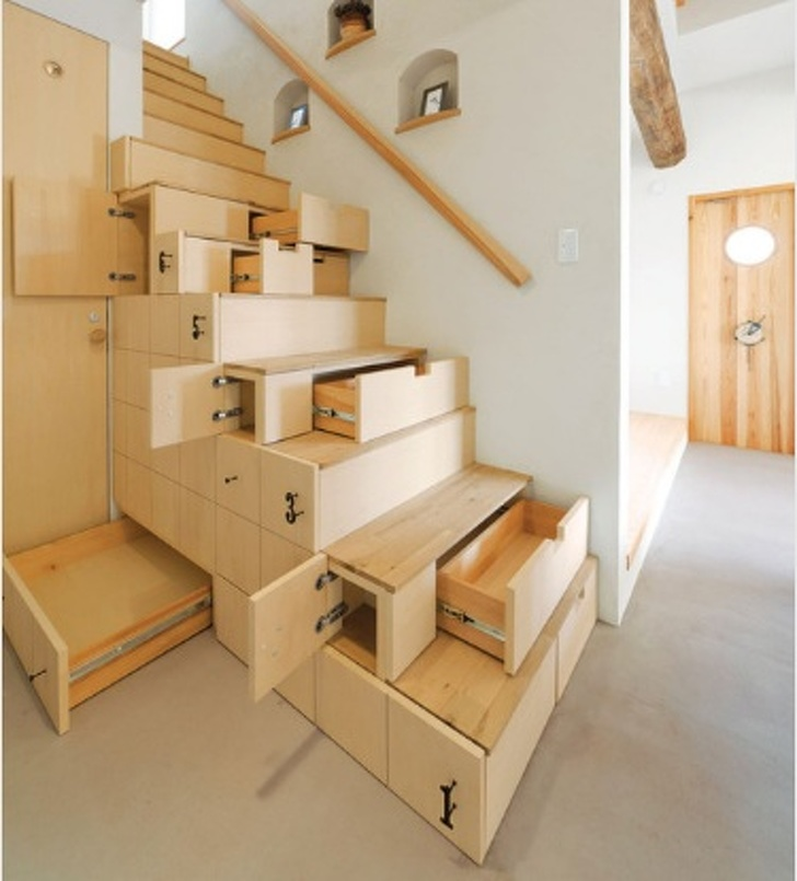 18 - Use all the space productively with staircase drawers.