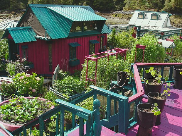 8 - The island features greenhouses, an art gallery and a lighthouse tower, all of which are fashioned from recycled materials and painted bright shades of pinks and purples. The couple grows their own food on the expansive gardens that weave through the property and harnesses the Sun's energy from an array of solar panels.