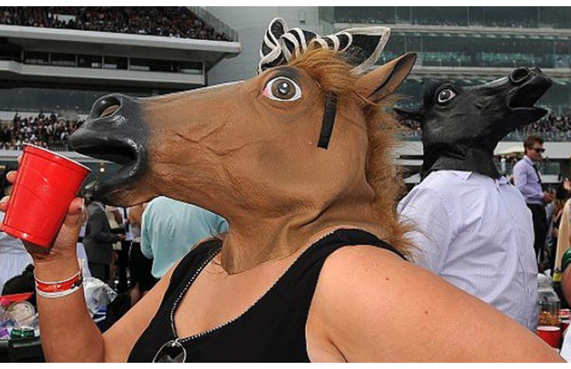 17 - Woman wearing a horse head in Kentucky Kentucky