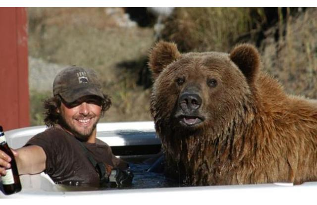 26 - Man in a hot tub with a bear in Montana Montana