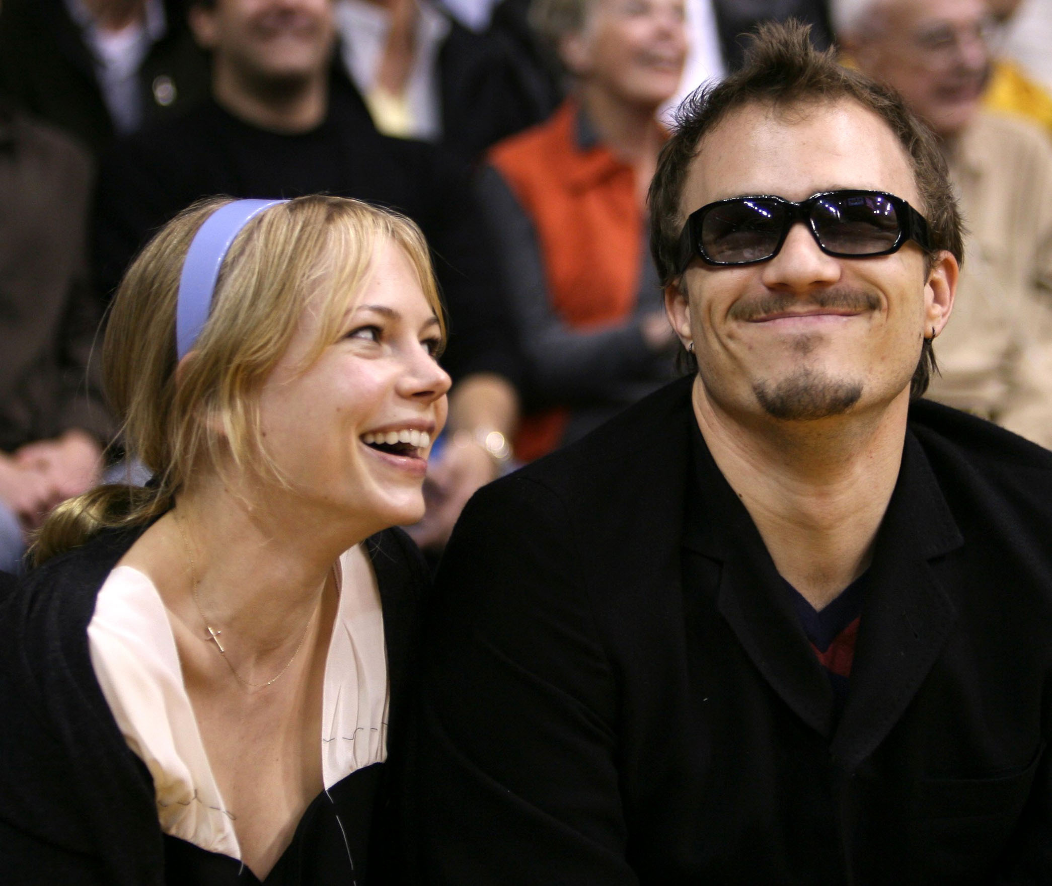 6 -  Michelle Williams and her boyfriend Health Ledger attend a basketball game in 2006.