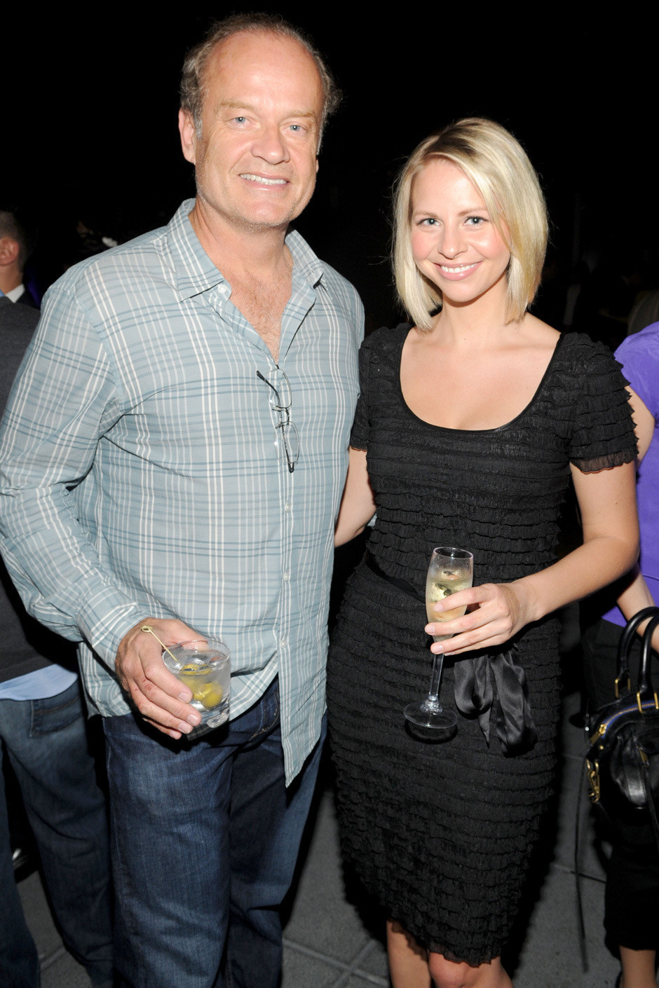 9 -  Kelsey Grammer with his girlfriend Kayte Walsh in 2010. Grammer started dating Walsh while still married to Camille Grammer whom he had been with the past 14 years.