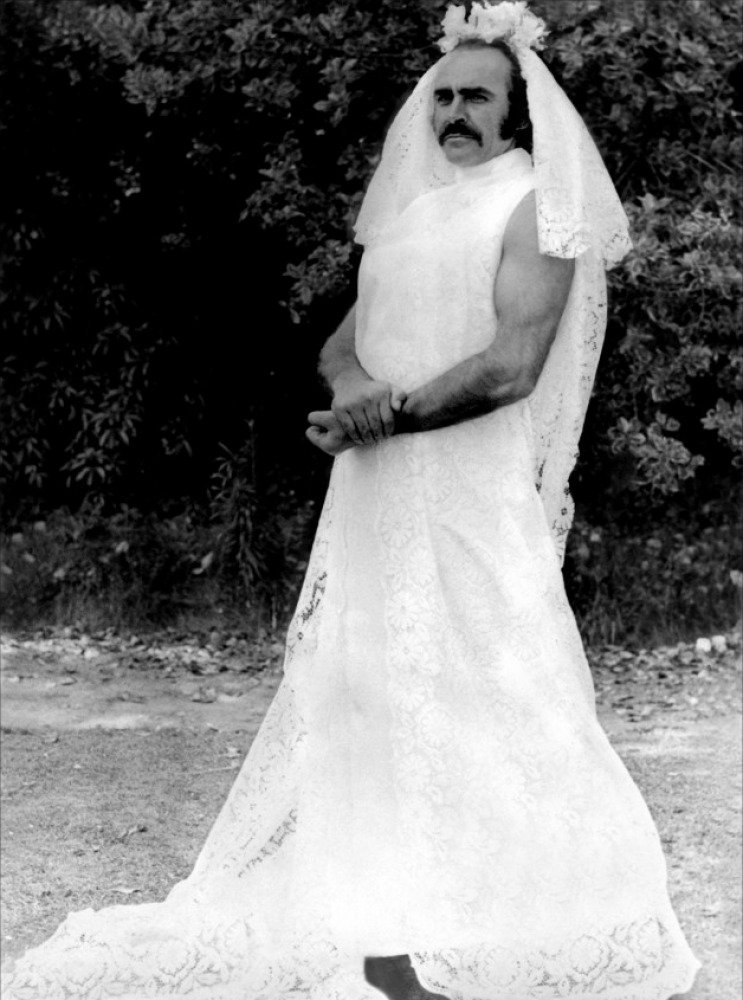 10 -  Sean Connery in a wedding dress waiting for a scene to begin filming while on set of Zardoz in 1974. WTF?