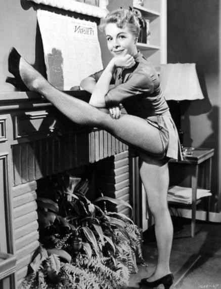 12 -  Marge Champion showing off her flexibility for a publicity shot sometime in the early 1950s. Marge and her then husband Gower Champion were a terrific dance team duo and choreographers for the MGM musicals of the time period.