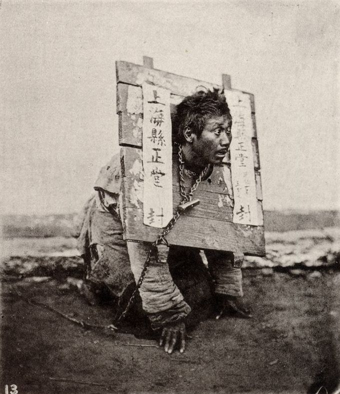 10 - A man wears a wooden 'cangue' around his neck as he is being punished by starvation for a crime in Shanghai, China in 1874. Depending on the severity of the crime, this could be a death sentence. It is unknown what happened to him.