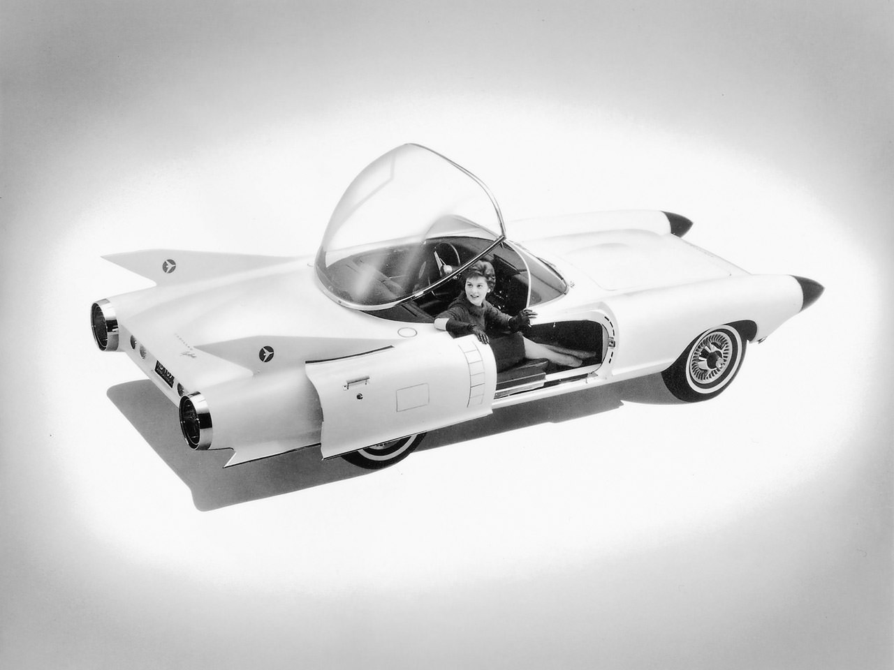 6 - A model sits in the Cadillac Cyclone in Detroit, US in 1959. This was a concept car built and shown off but never went into production.