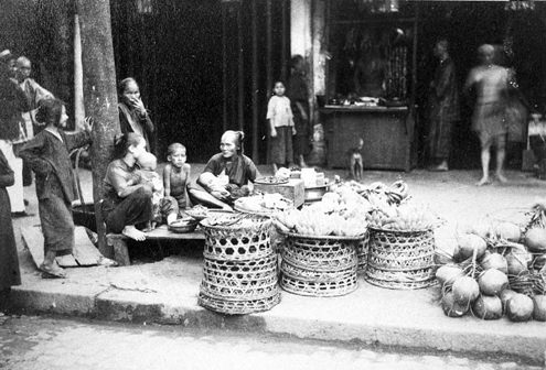 7 - Vendors selling goods on the streets of Saigon, Vietnam in 1890.