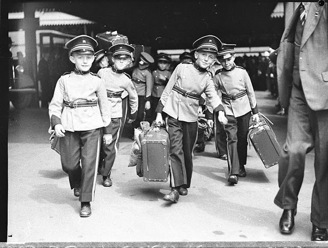 17 - Young boys work as baggage handlers at a train station in New South Wales, Australia in 1936.