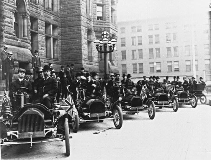 23 - Tommy Russell (driving the first car on the left) shows off a row of Russell Motor Cars in Toronto, Canada in 1909. His company was the first successful Canadian car company.
