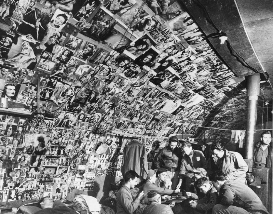 25 - Hundreds of pictures of pinup girls line the walls of this bomber crews shack on Adak Island in the Aleutians in Alaska, US in 1943.